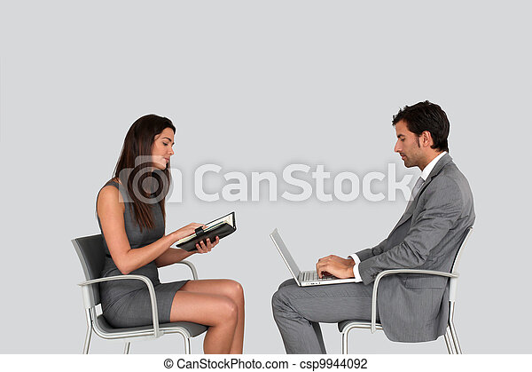 Business people in meeting- isolated - csp9944092