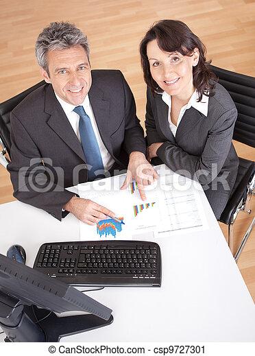 Business people in the office at the meeting - csp9727301