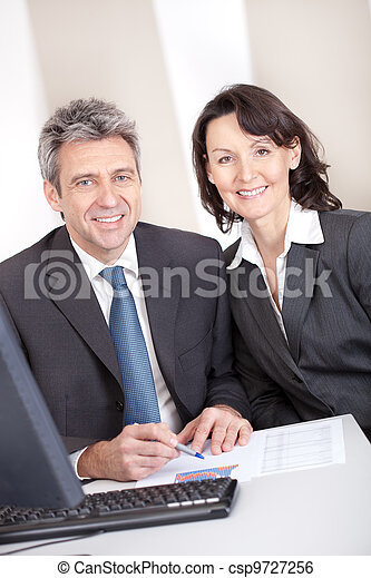 Business people in the office at the meeting - csp9727256