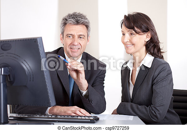 Business people in the office at the meeting - csp9727259