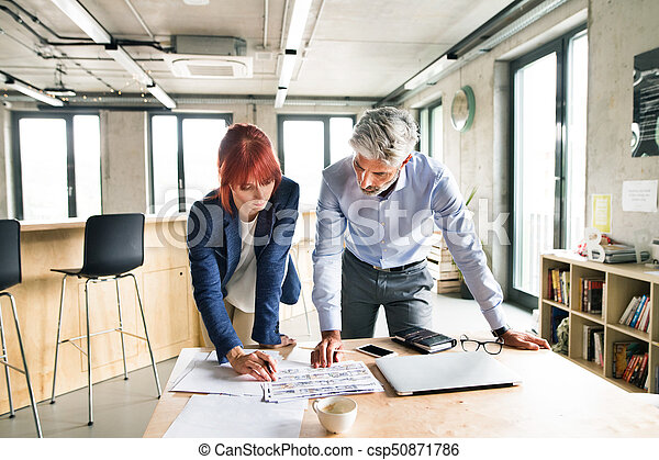 Business people in the office talking together. - csp50871786