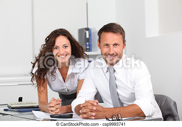 Business people in the office working on building project - csp9993741