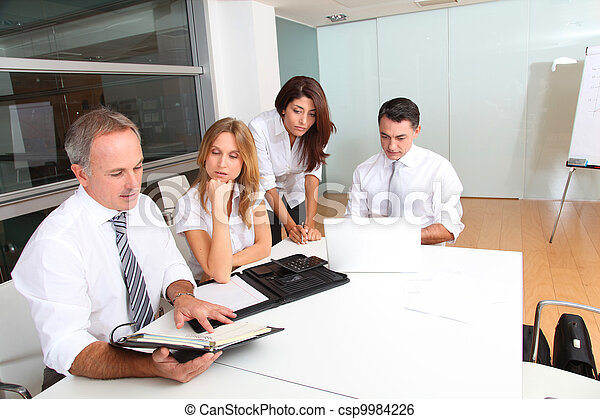 Business people meeting around table - csp9984226