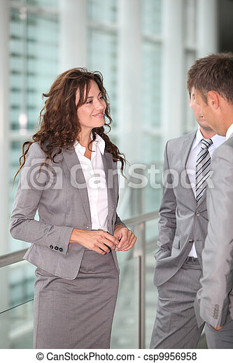 Business people meeting in a hall - csp9956958