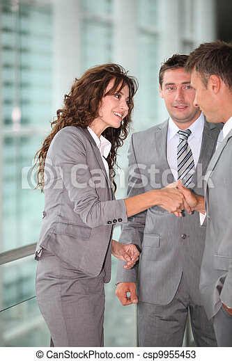 Business people meeting in a hall - csp9955453