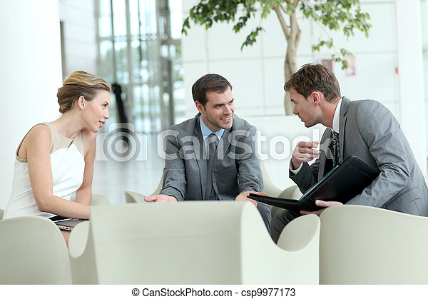 Business people meeting in airport lounge - csp9977173