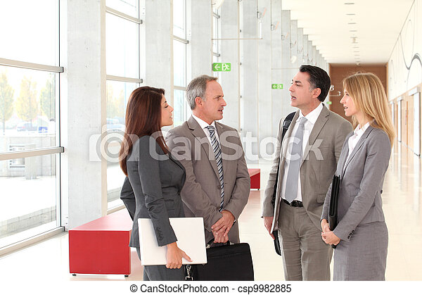 Business people meeting in congress hall - csp9982885