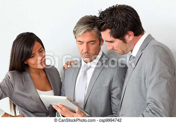 Business people meeting in hall with tablet - csp9994742