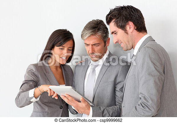 Business people meeting in hall with tablet - csp9999662
