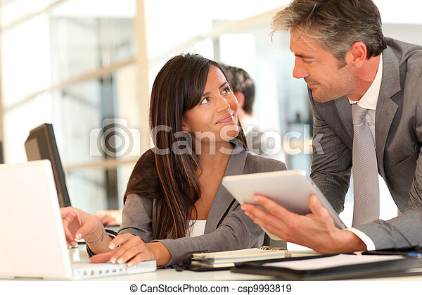 Business people meeting in office - csp9993819