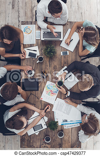 Business people meeting in the office top view - csp47429377
