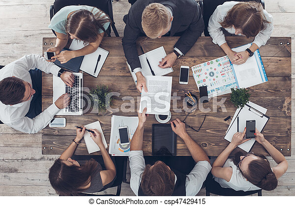Business people meeting in the office top view - csp47429415