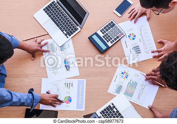 Business People Meeting in the office concept, Using Ideas, Charts, Computers, Tablet, Smart devices on business planning on the table. - csp58977673