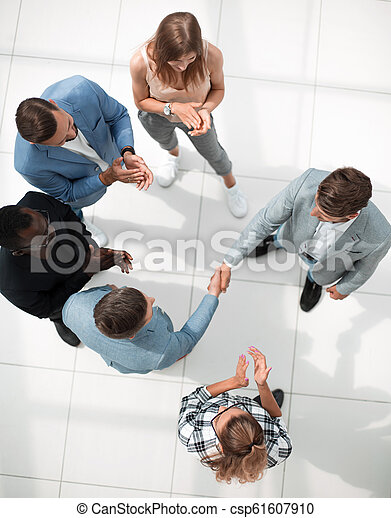 Business people meeting in the office top view - csp61607910