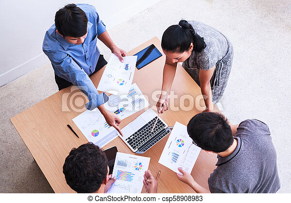 Business People Meeting in the office concept, Using Ideas, Charts, Computers, Tablet, Smart devices on business planning on the table. - csp58908983
