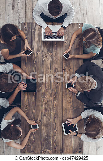 Business people meeting in the office top view - csp47429425