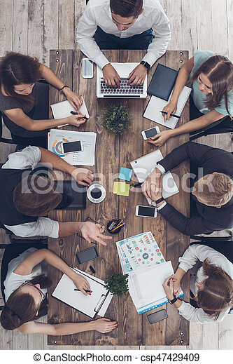 Business people meeting in the office top view - csp47429409