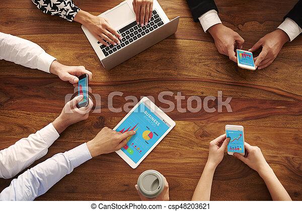 Business people negotiating in meeting - csp48203621
