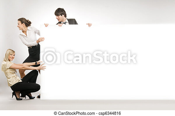 Business people pulling big white board, lots of copyspace - csp6344816
