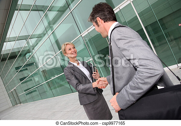 Business people shaking hands after meeting - csp9977165