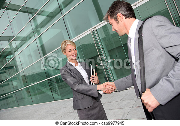 Business people shaking hands after meeting - csp9977945