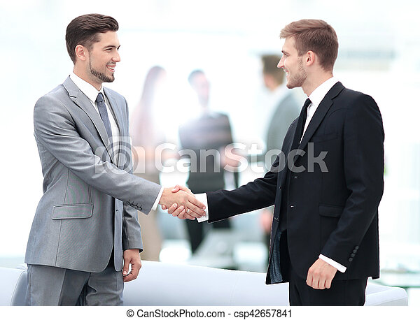 Business people shaking hands during a meeting - csp42657841