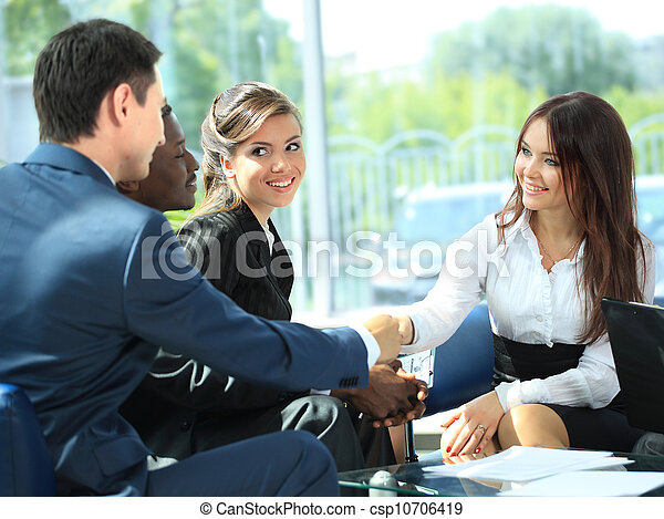 Business people shaking hands, finishing up a meeting - csp10706419