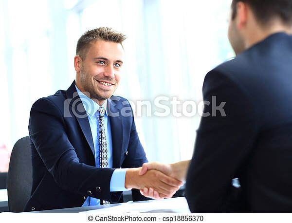 Business people shaking hands, finishing up a meeting - csp18856370