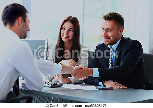 Business people shaking hands, finishing up a meeting - csp53808178