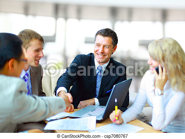 Business people shaking hands, finishing up a meeting  - csp7080767