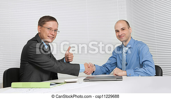 Business people shaking hands, finishing up a meeting - csp11229688