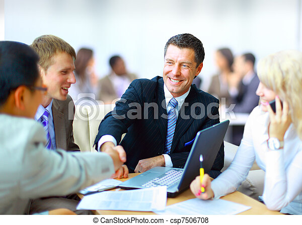 Business people shaking hands, finishing up a meeting - csp7506708