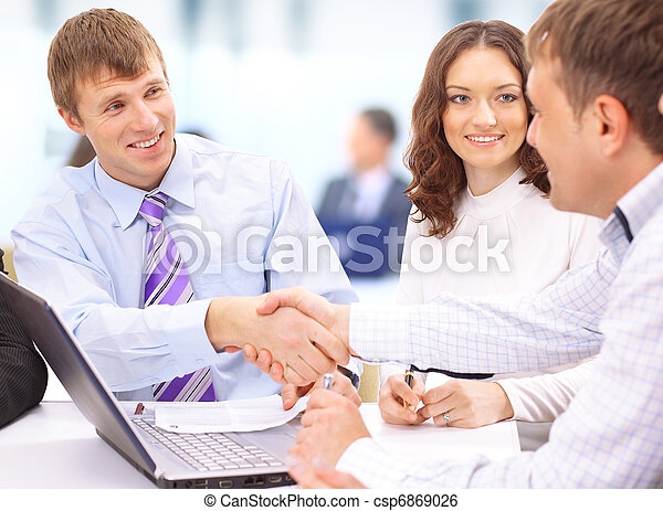 Business people shaking hands, finishing up a meeting  - csp6869026