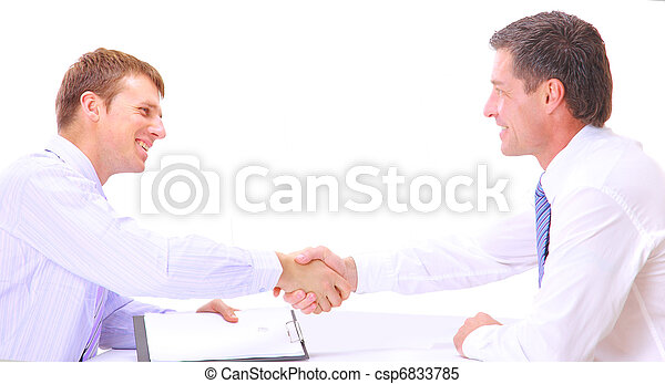 Business people shaking hands, finishing up a meeting  - csp6833785