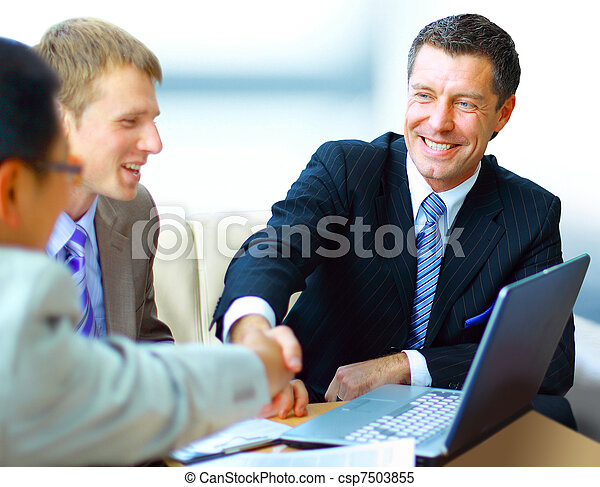 Business people shaking hands, finishing up a meeting  - csp7503855