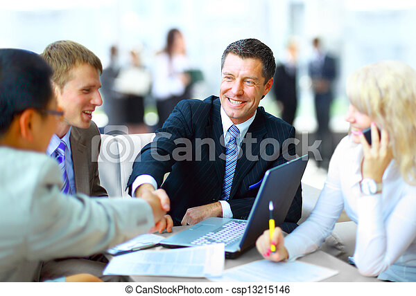Business people shaking hands, finishing up a meeting  - csp13215146