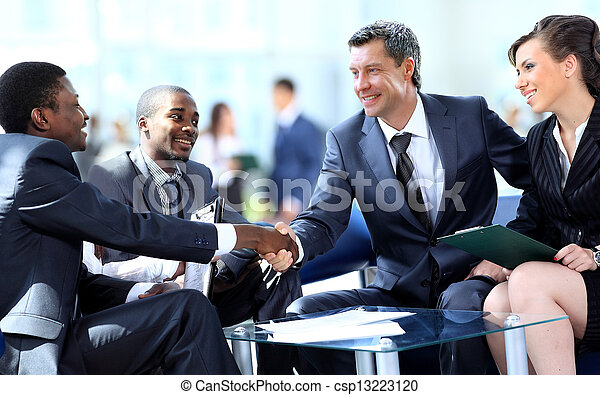Business people shaking hands, finishing up a meeting - csp13223120