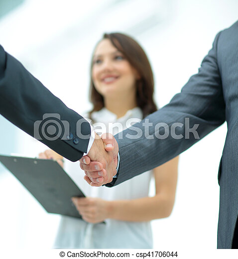 Business people shaking hands, finishing up a meeting - csp41706044