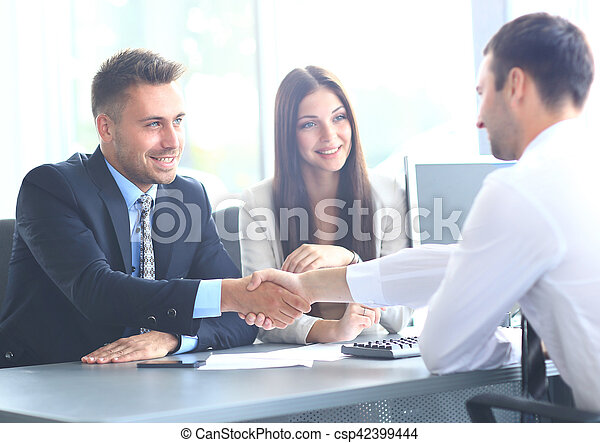 Business people shaking hands, finishing up a meeting - csp42399444