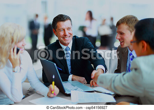 Business people shaking hands, finishing up a meeting. - csp54156927