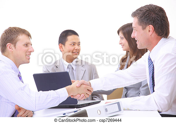 Business people shaking hands, finishing up a meeting  - csp7269444