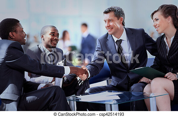Business people shaking hands, finishing up a meeting - csp42514193