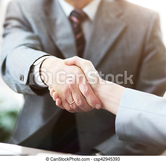 Business people shaking hands, finishing up a meeting - csp42945393