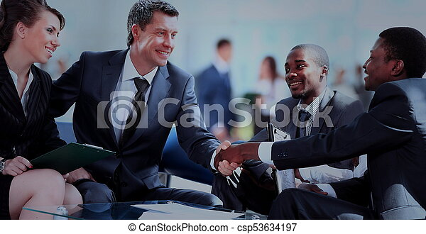 Business people shaking hands, finishing up a meeting - csp53634197