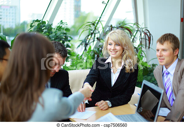 Business people shaking hands, finishing up a meeting  - csp7506560