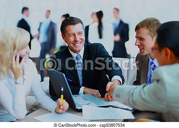 Business people shaking hands, finishing up a meeting. - csp53807534