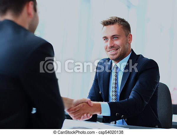 Business people shaking hands, finishing up a meeting. - csp54020138