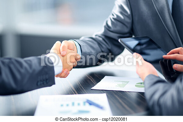 Business people shaking hands in office - csp12020081