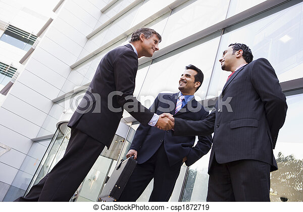 Business people shaking hands outside office - csp1872719