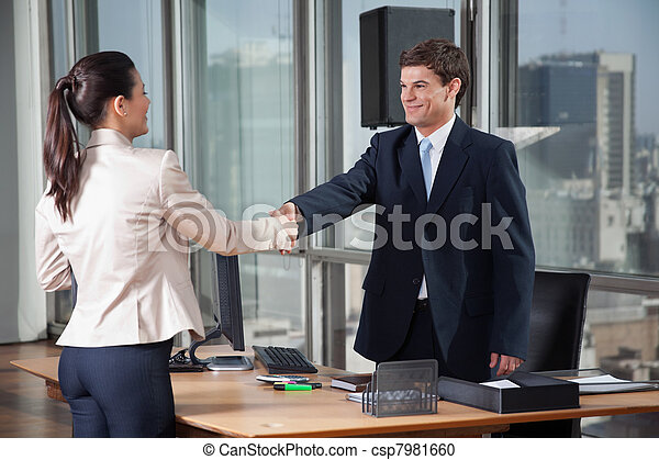 Business People Shaking Hands Over A Deal - csp7981660